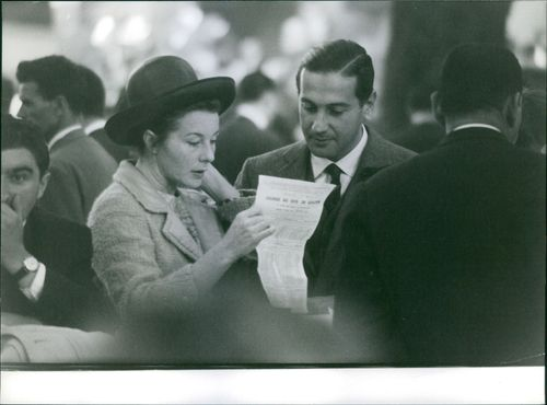 A LADY SHOWS A SCRIPT TO A MAN