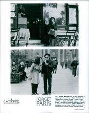 "A photo of Debra Winger & Billy Crystal in a film ""Glom Paris""."
