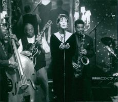 Whitney Houston singing with the band in the movie The Preacher's Wife, 1996.