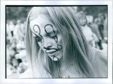Close up of a woman with face painting.