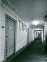 An empty illuminated corridor, outside the William Averell Harriman's hotel room in Paris.