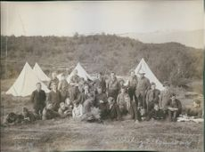 Boys scout gathered outside their camp. 1916