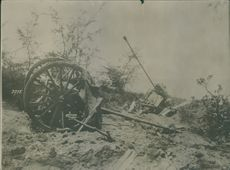Destroyed cannon and carriages in the street during the World War I in 1914-1918.