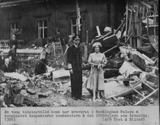 King George VI and Queen Elizabeth I inspect the bomb crater after the time bomb has demanded at Buckingham Palace