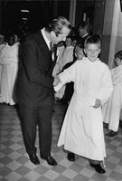 Prince Laurent of Belgium, on his alb, with father Albert.