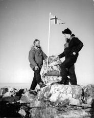 Norwegian standing on the rock with a flag of Norway in Greenland, 1962.