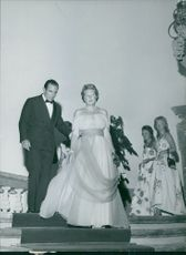 Princess Christina stepping downstairs in at an event.