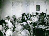 Rebels discussing in a room in Yemen.