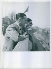 A group of man having conversation on the top of building.1939