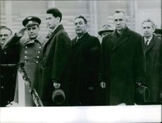Vladimir Mikhaylovich Komarov with officers standing together and saluting someone.