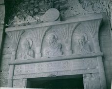 """This plaque over the entrance to the Monastery depicts """"Peace"""". It will be restored to its original place in the new building."""