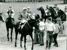 Horse jockeys riding their horses.  Taken - 5 July 1966