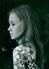 Side pose of Hayley Mills.