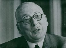 A vintage photo of a French politician Rene Pleven in a conversation act.