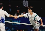 Arnaud Boetsch thanks for a match over the net during the Stockholm Open 1996