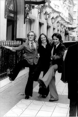 Marty Feldman, Loretta Sullivan and Michel Drucker show off at a photograph on the streets of Paris.