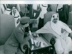 A military official taking to King Saud of Saudi Arabia.