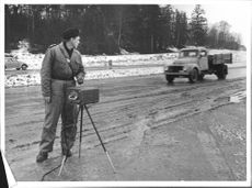 Police Assistant Per Roland Martling testing a tuning fork radar at road edge