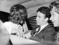 Brigitte Bardot inside a vehicle with Jacques Charrier.