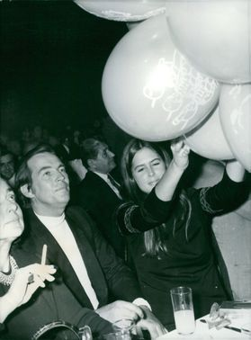 A lady holding the balloon during the event. December 1, 1970
