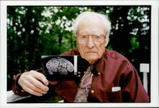 Dr. Thomas Harvey with a picture of Professor Albert Einstein's brain. Einstein is considered to have had one of the most creative intellect in the present time.