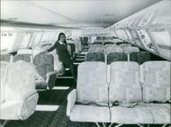 A flight attendant inside a plane. September 1, 1968.