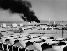 Thick, black smoke coming out of Melet's factory chimneys.  - 1964
