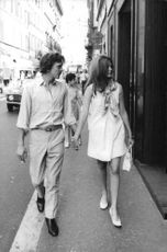David Edward Leslie Hemmings walking with a woman holding hands.