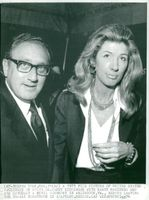 Henry Kissinger with his wife Nancy after their wedding in Arlington