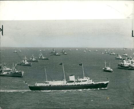 The royal yacht britannia with the queen prince philip and princess anne.