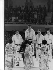 The winners of Judo-competition being awarded with medals.