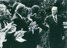 President Gerald Ford of the United States shaking hands with dignitaries in the White House Rose garden.  - 1975