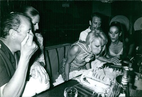 France Anglade celebrating birthday with Claudine Auger and other people. Photo taken in July 1966.