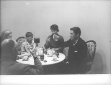 Frank Andersson enjoying drink with family.