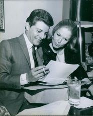 Frankie Avalon and his wife Kathryn Diebel reading a paper. Photo taken on January 27, 1964.
