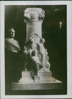 Sculptures of Enrico Caruso with other figurine.