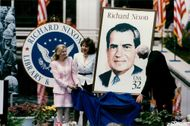 Richard Nixon's daughters Tricia Cox and Julie Eisenhower along with postmaster Marvin Runyon and the new Nixon stamp