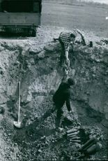 Photo shows an excavated live remains of bombs and ammunitions from war.