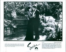 A still from the film Sabrina with Harrison Ford and Julia Ormond.