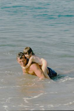 Robert F. Kennedy Jr. Bathing in the ocean with his daughter