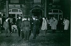 People gathered in front of building.
