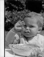 Jacques Charrier (baby) having his food.