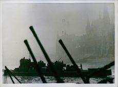 German soldiers standing and moving by boat.