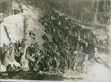 """Soldiers climbing and gathered on the cliff in Cividale del Friuli.  """"Cividale del Friuli ___""""  1936"""