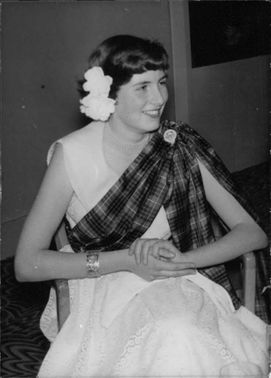 Portrait of Amabel Yorke sitting and smiling.