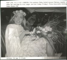 Rock Singer Jim Kerr and film actress Patsy Kensit leave Chelsea register office after their wedding.