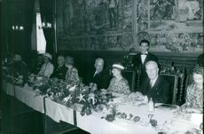 The Royal couple of France siting together and having dinner.