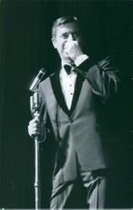 Jerry Lewis performing while holding on a microphone stand