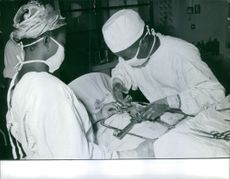 Patient being treated by the doctor, nurse assisting.