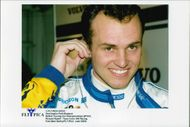 Portrait image of Rickard Rydell taken in conjunction with a BTCC contest at Donnington Park.